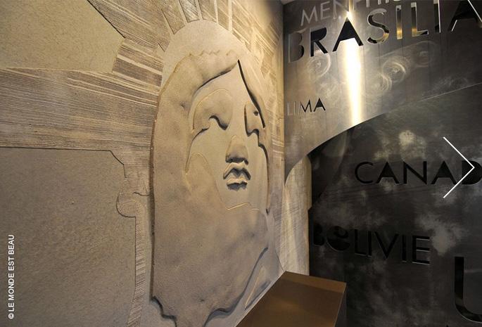 Objectif Amériques, agence de voyage, enduit minéral à la chaux en bas relief, Design Agence Richard Bagur, Lyon 2011